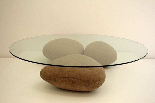 At first glance, this modern coffee table appears to be made of rocks, but it is actually cardboard. #FurnitureDesign #CoffeeTableDesign