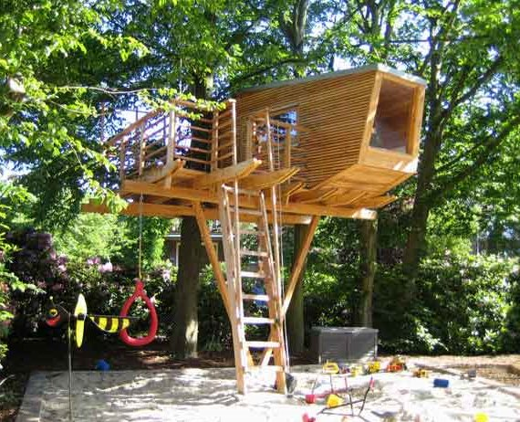 A modern treehouse with integrated play equipment.
