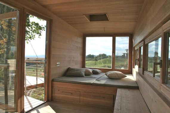 Wood treehouse interior with a bed.