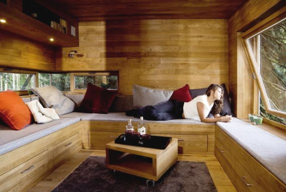 A modern treehouse interior with built-in benches.