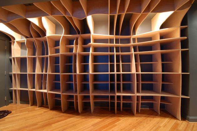 ... below, and watch a video of them installing the bookshelf – here