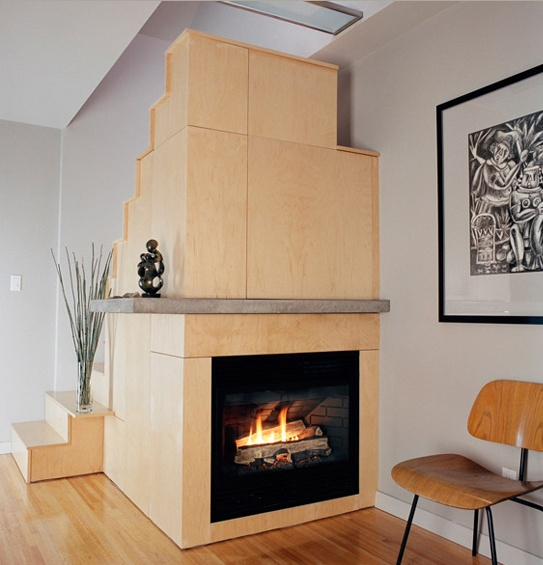 Staircase with fireplace
