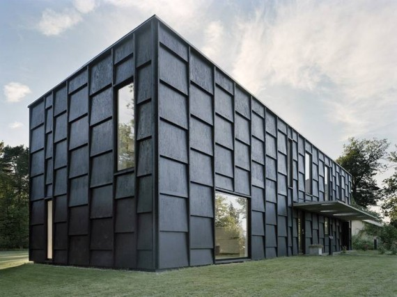 A modern black house with oversized shingles.