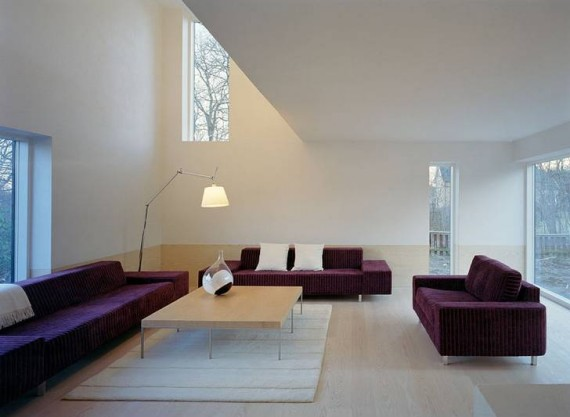 A white interior with deep purple furniture.