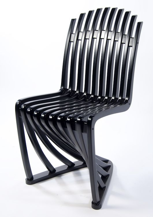 ... Chair, Instead Of Being Made From Plastic, The Swept Curves Of This  Chair Are Made By Building It Up In Several Layers, Each Cut From Birch  Plywood ...