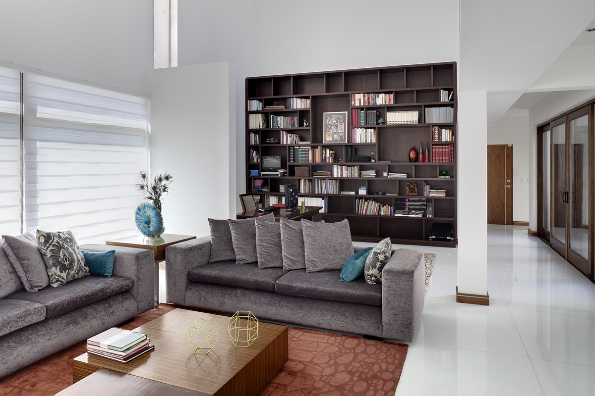 Contemporary-luxury-living-room-interior-design-with-modern-gray-sofas-and-wooden-small-table-and-bookshelv-design-ideas.