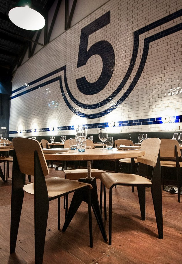 This restaurant has a large blue and white tiled feature wall.