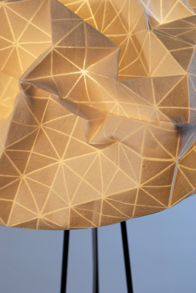 mika lighting. the light coming through fabric also reveals inner geometric structure printed on inside of mika lighting