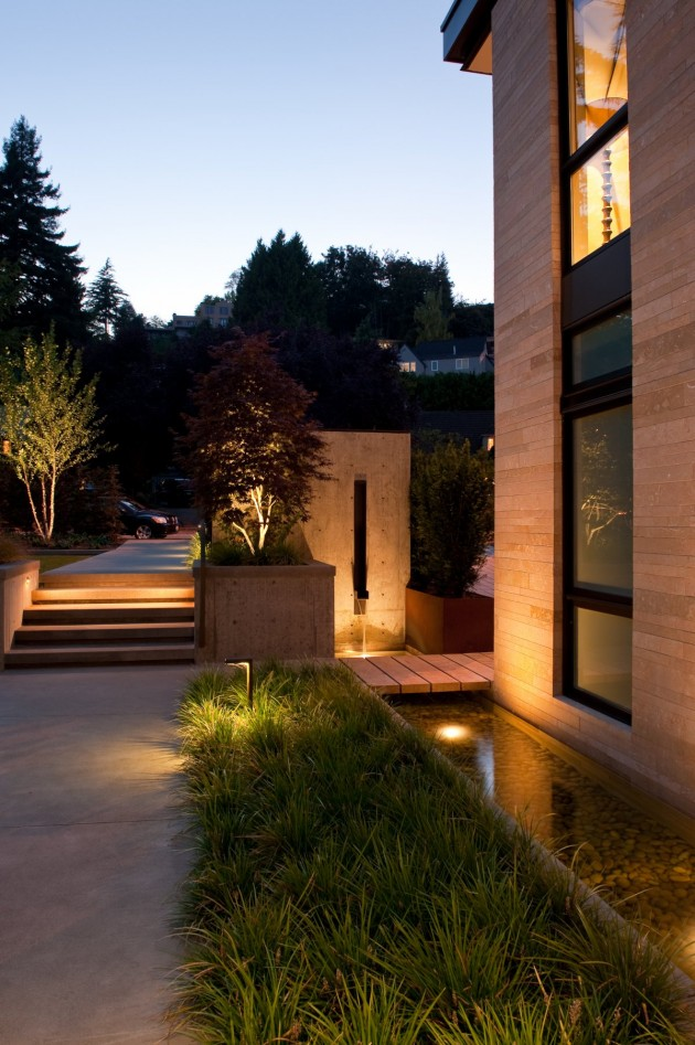The landscaping around this home has lighting included to help show the various garden features.