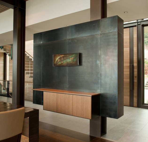 This custom-designed steel feature partition has a cabinet attached for storage.