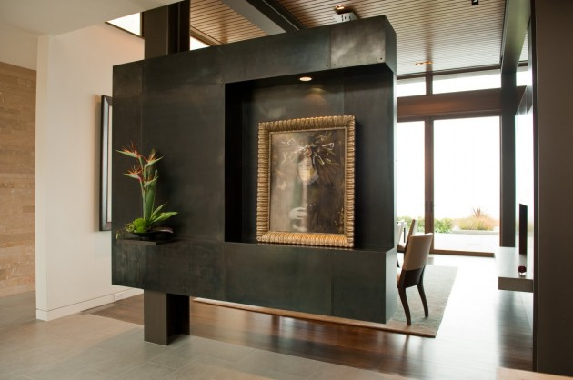 This custom-designed steel partition has a section cut out specifically for displaying artwork.