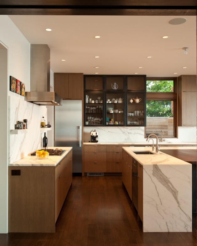 This kitchen has a glass cabinet to show off your favorite kitchen items.