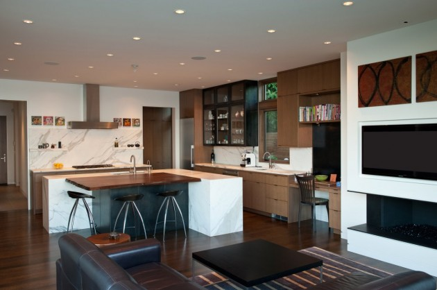This kitchen has a large island with space for sitting, and a built-in desk.