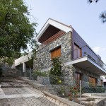 House with a wooden skin by VARDAstudio