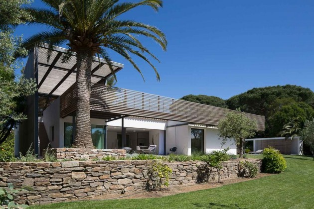 This home in Saint Tropez has a stone wall as part of their landscaping.