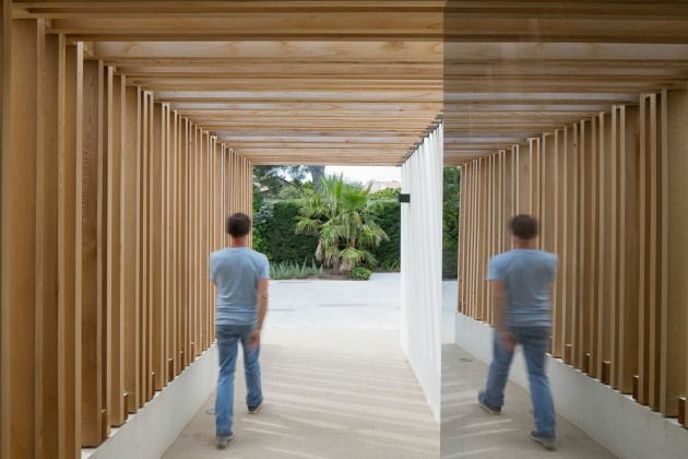 This entryway is covered in wood.