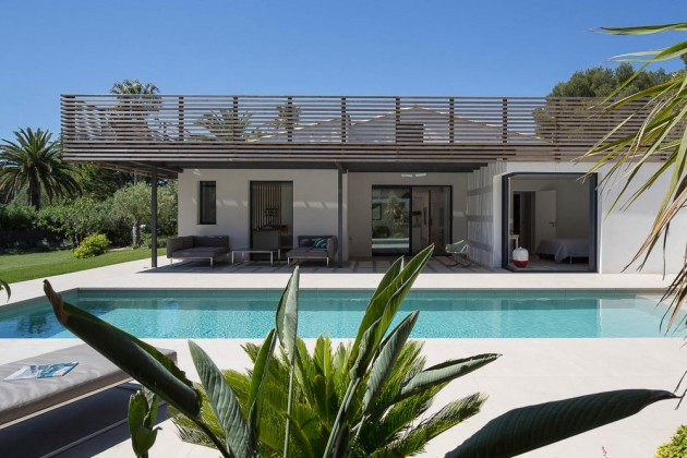 This home in Saint Tropez has a shaded area next to the swimming pool.