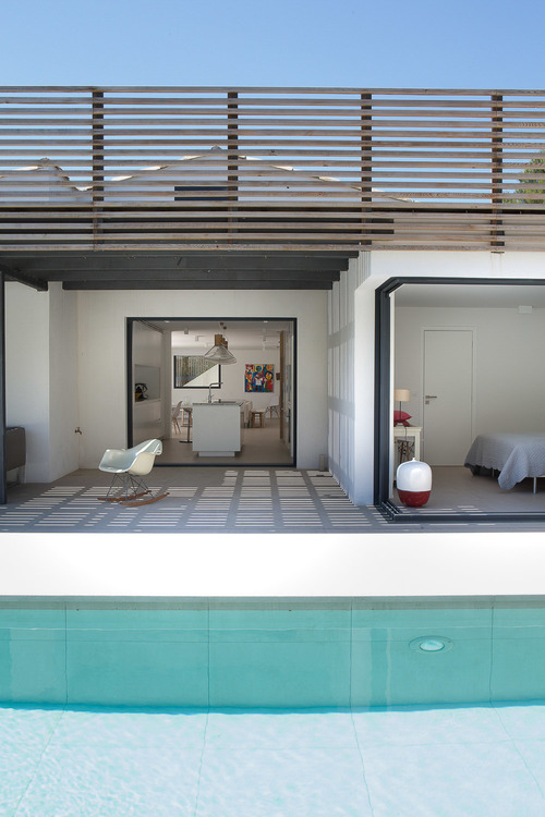 This home opens up to the swimming pool and patio.