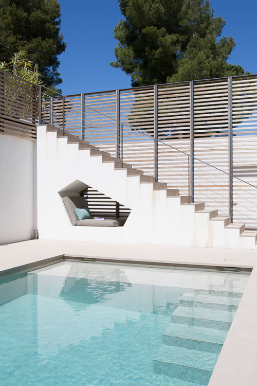 This built-in seating nook by the swimming pool of a house in Saint Tropez.