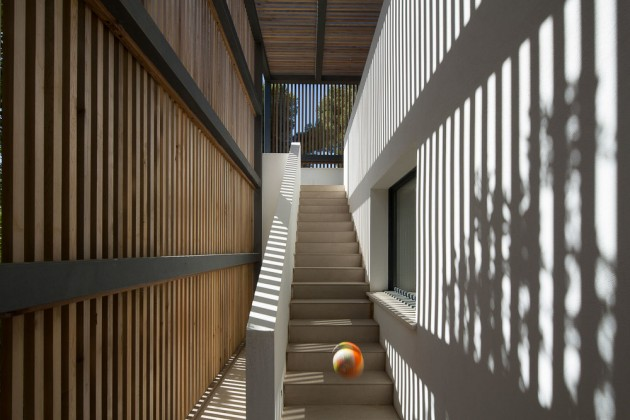 Shade is provided to this staircase by a wooden slat surround.