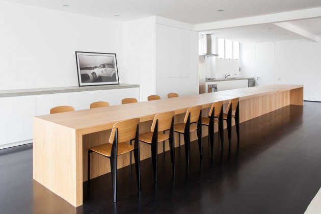 a huge kitchen island/dining table takes center stage in this