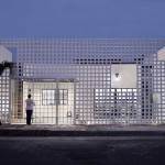 Natura Futura Architecture designs a screen to surround a home's courtyard