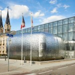 A stainless steel shell welcomes visitors to this city hall building