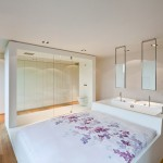 This Apartment Bedroom Has A Bed Attached To A Bathtub And Two Sinks