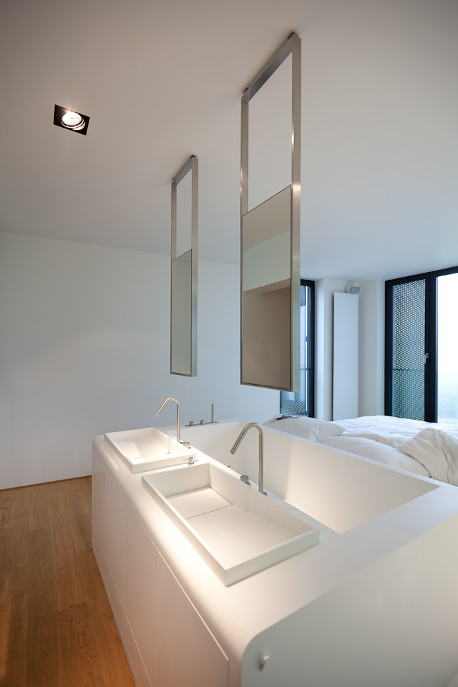 This Apartment Bedroom Has A Bed Attached To A Bathtub And Two Sinks ...