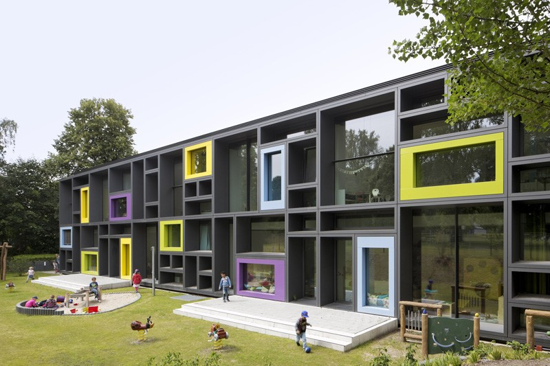 This children's day care has a facade of bold blocky shapes that give hints at the fun to be had inside