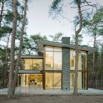 Engel Architecten completes a villa surrounded by trees