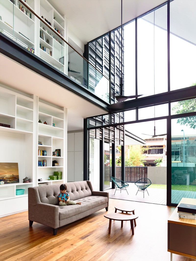 A corner terrace house for a family in singapore for Terrace house opening new doors