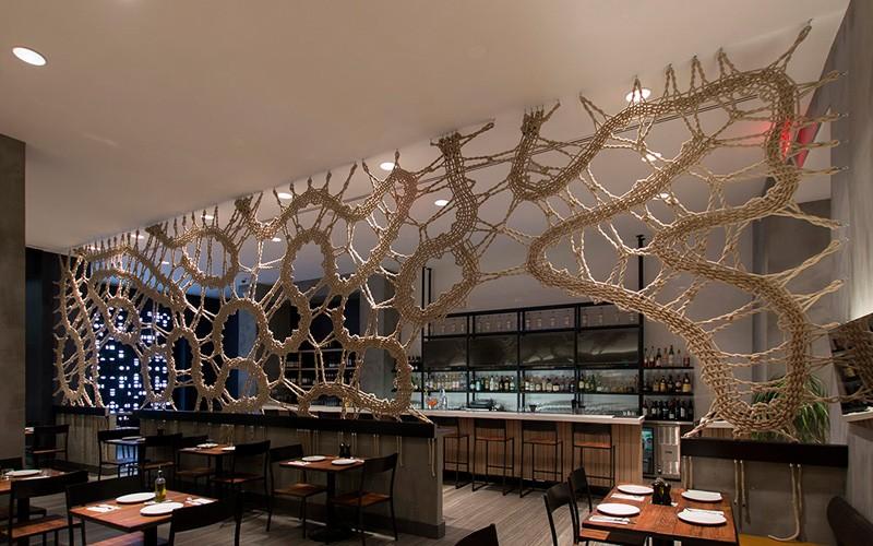 MANTZALIN have designed a rope screen for Stix, a new Mediterranean restaurant in Chelsea, New York. #RopeScreen #RestaurantDesign #RestaurantInterior #Rope #InteriorDesign