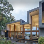 An Island Home With A Folding Roof That Floats Over A Ridge