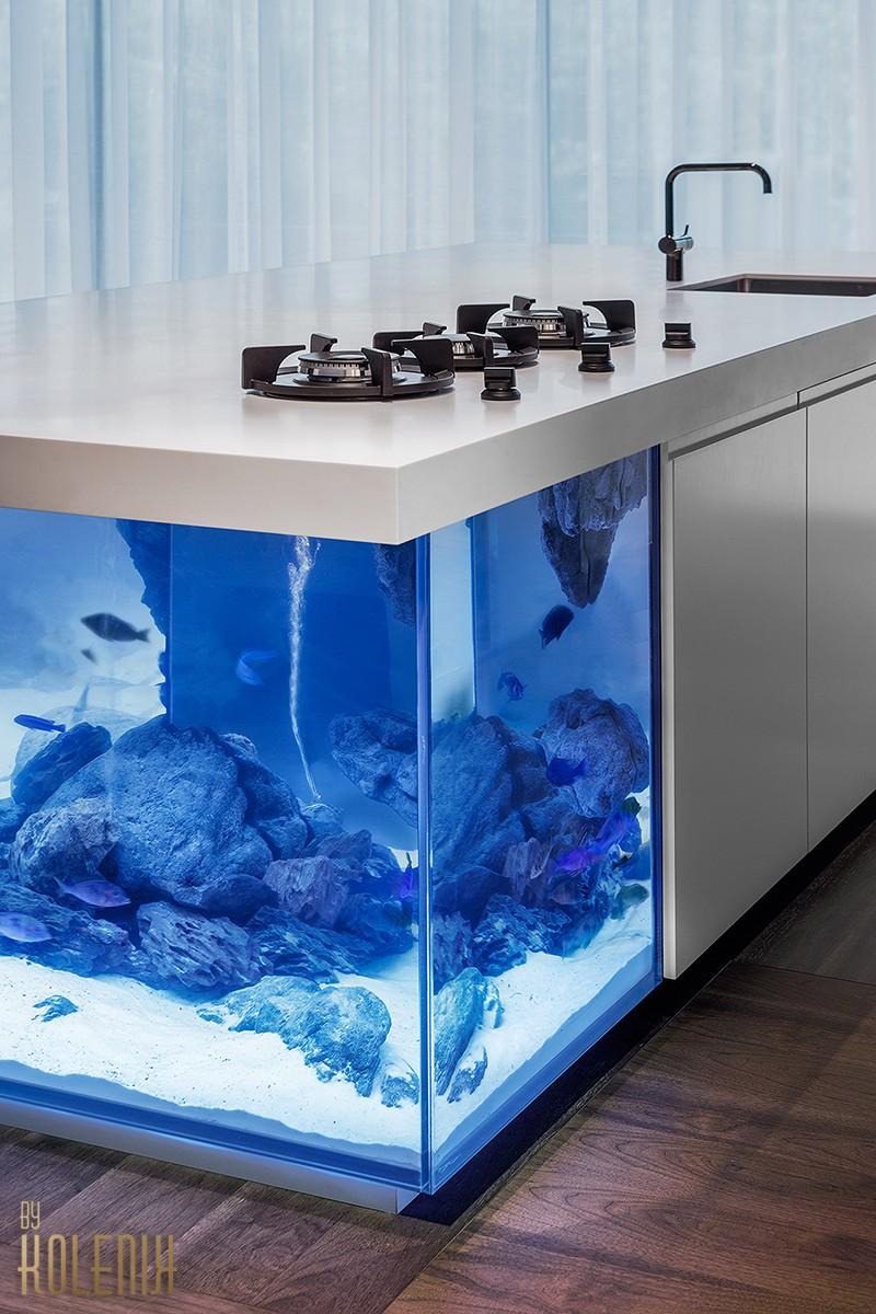 A kitchen island with an aquarium inside it