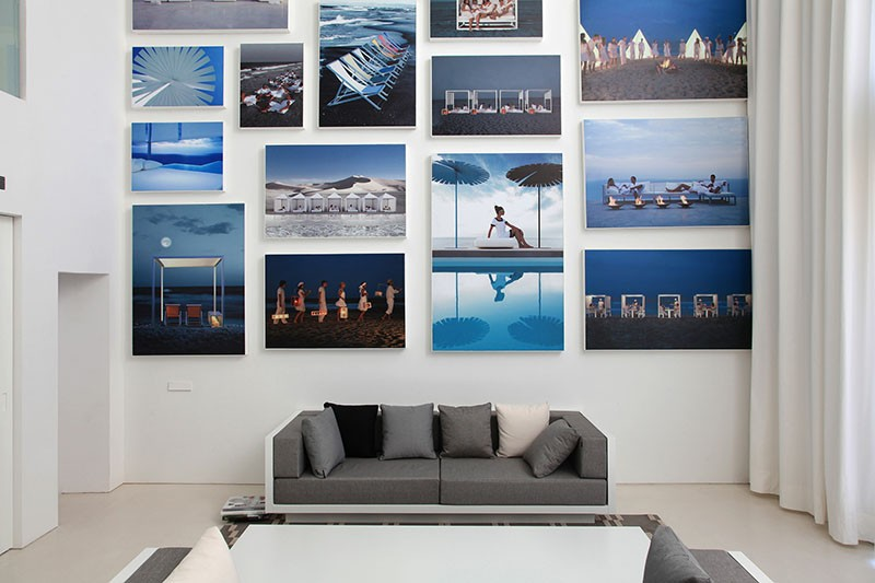 A Wall Of Illuminated Backlit Photos