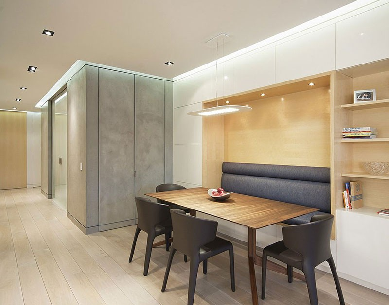 Built-in banquette seating creates a cozy atmosphere for this dining area.