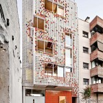 A Facade Of Colorful Ceramic Blocks Cover This Apartment Building