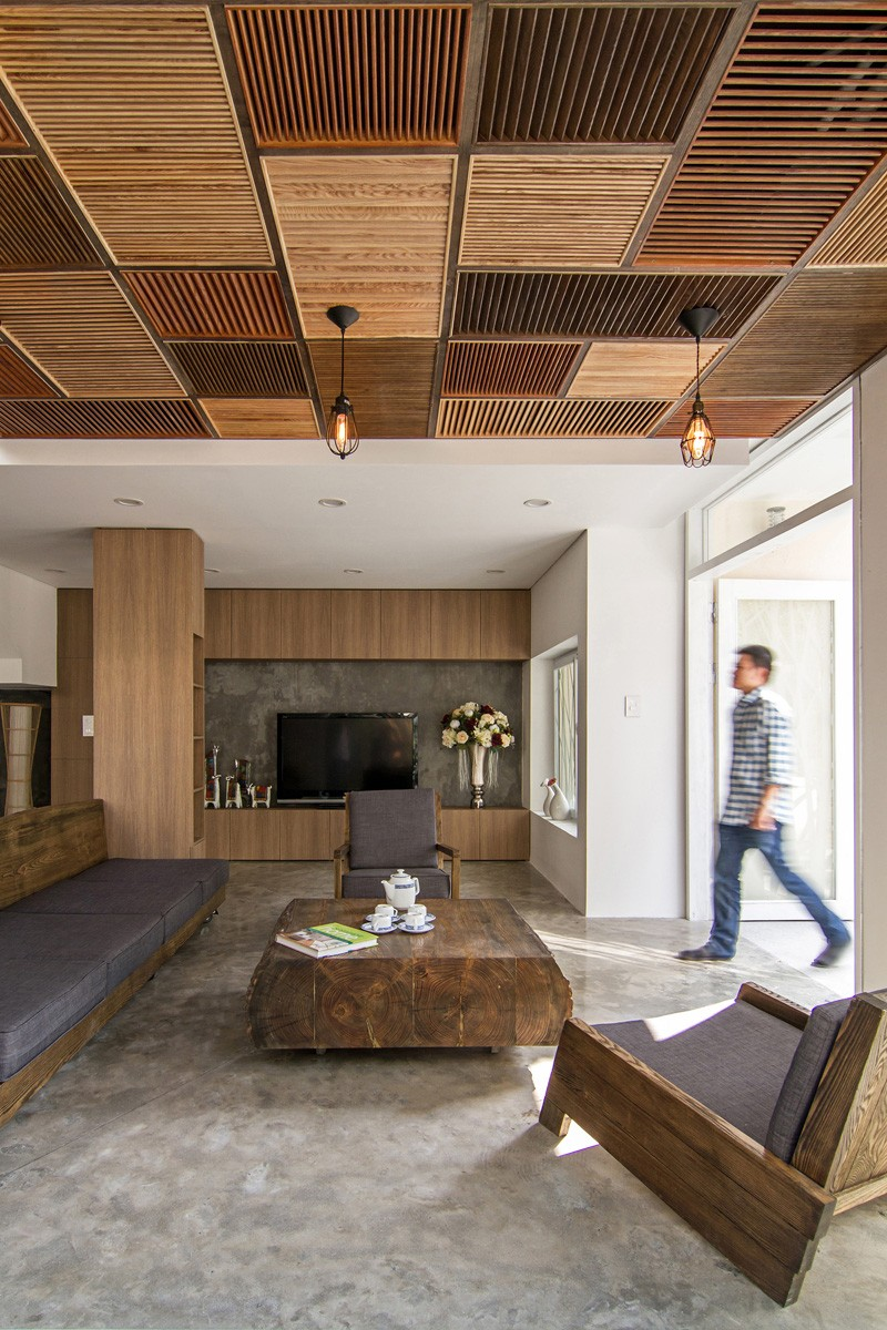 A Patchwork Of Wood Shutters Cover The Wall And Ceiling In