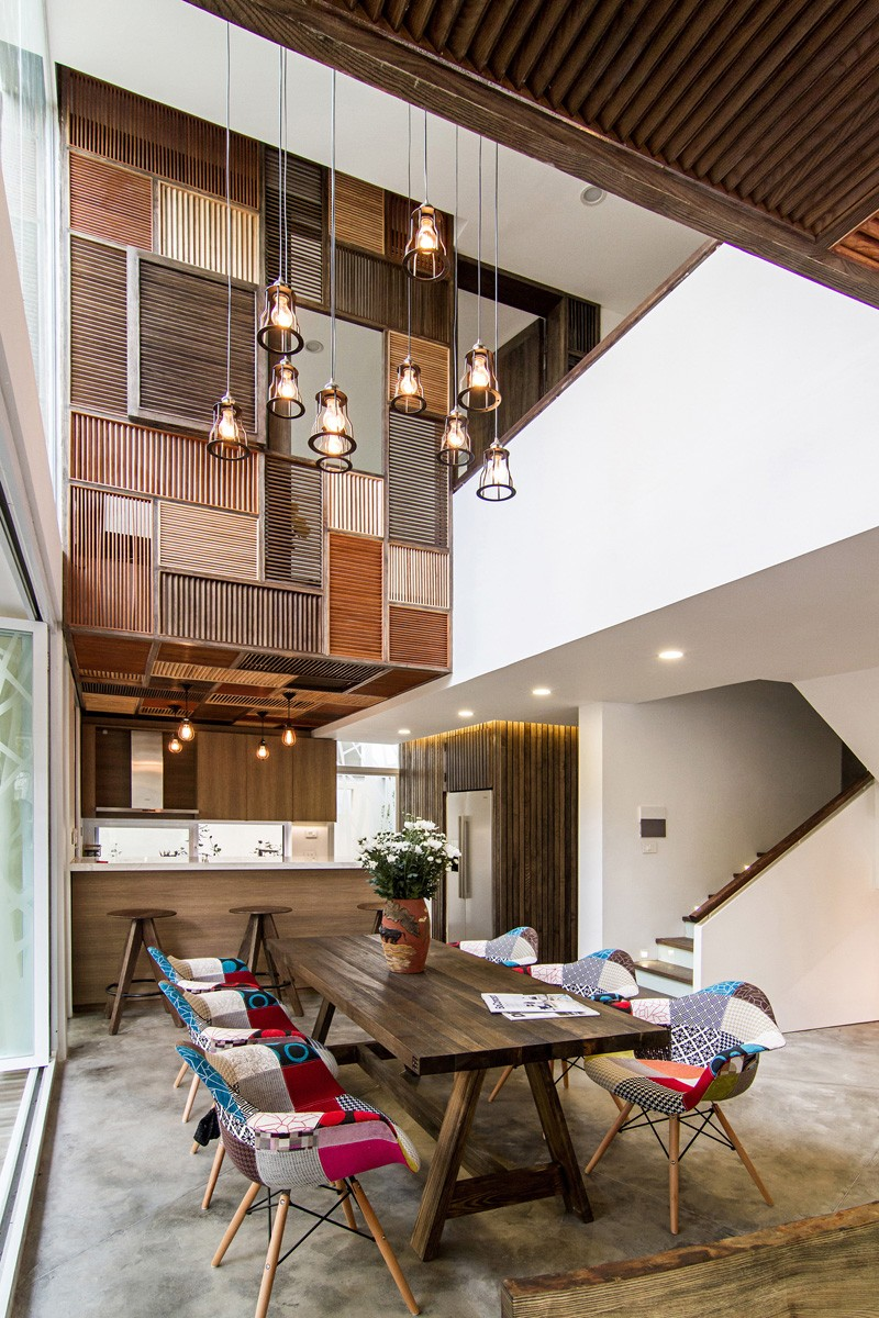 A patchwork of wood shutters cover the wall and ceiling in for Interior design in vietnam
