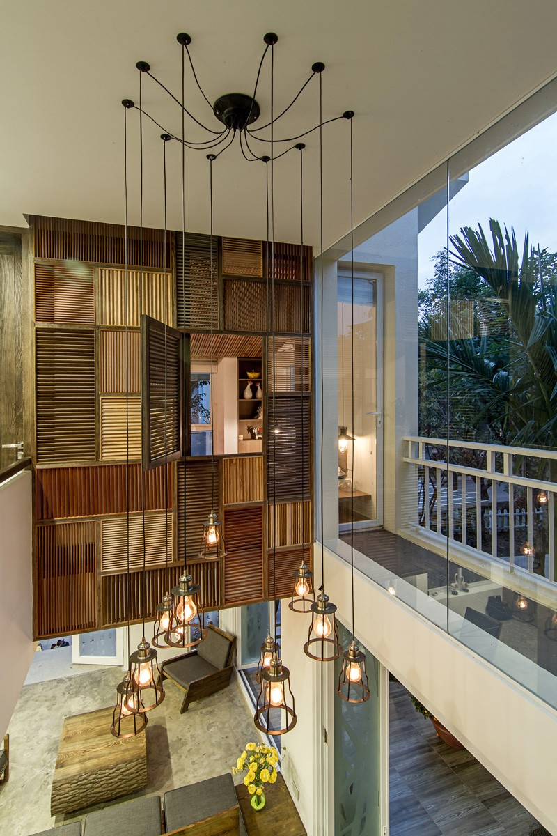 A Patchwork Of Wood Shutters Cover The Wall And Ceiling In ...