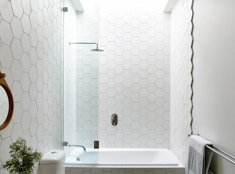 Hexagonal Tiles On A Bathroom Wall