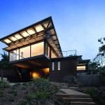 This Home Is Clad In Burnt Wood And Weathered Steel To Fit Into The Surrounding Landscape
