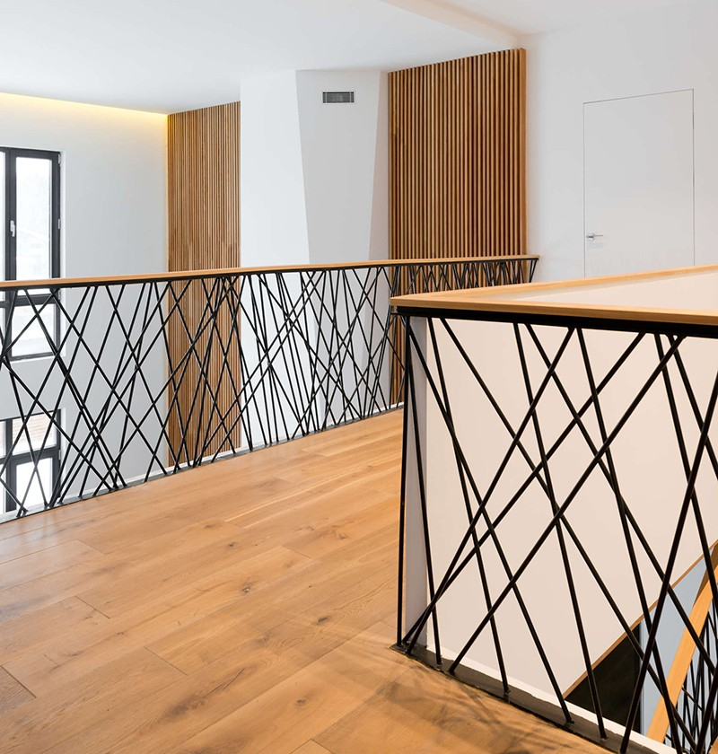 This home designed by Monoloko Design, features custom railings on the stairs and the top floor, made from randomly placed steel supports that have been powder coated black. #StairRails #StairRailing #StairDesign #StairHandrail