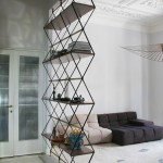 Pietro Russo Designs A Floor-To-Ceiling Shelf & Space Divider