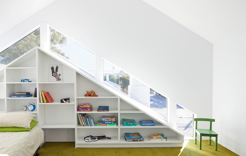 Shelves that follow the lines of the window