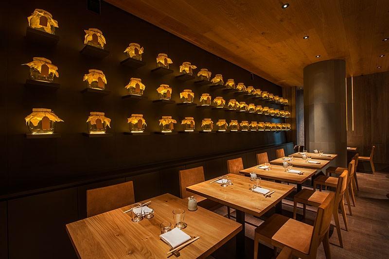 A Wall Of Uplit Glass Jars