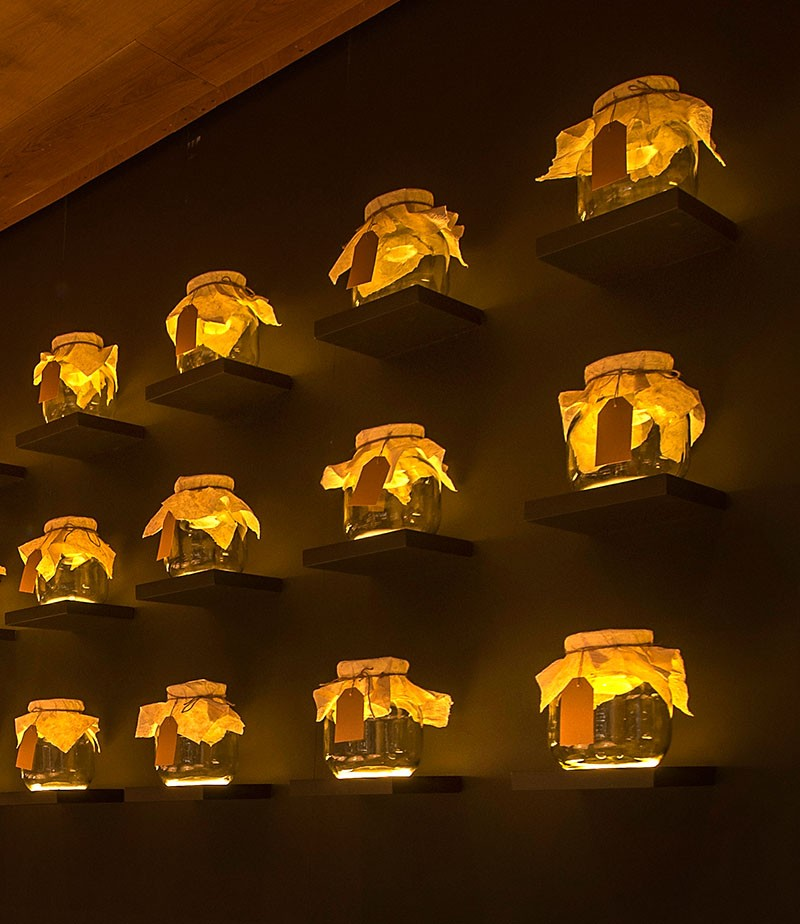 A Wall Of Uplit Glass Jars