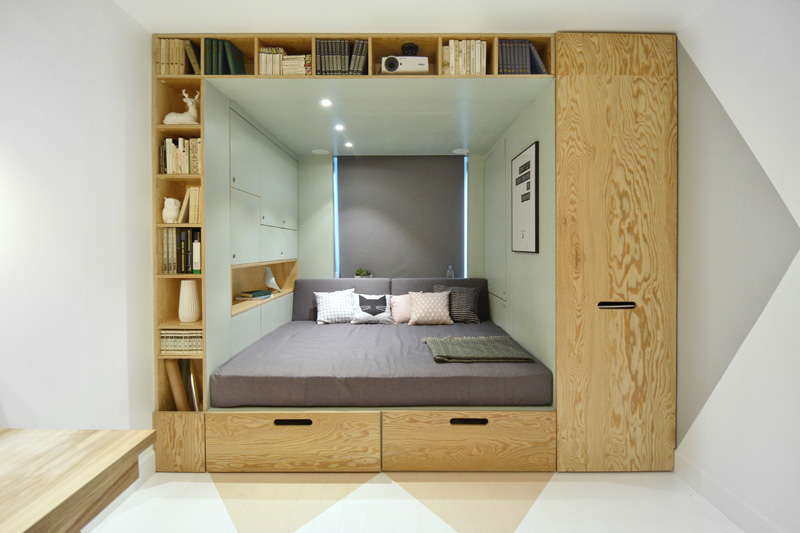 this teenager's bedroom has a built-in bed and storage for almost
