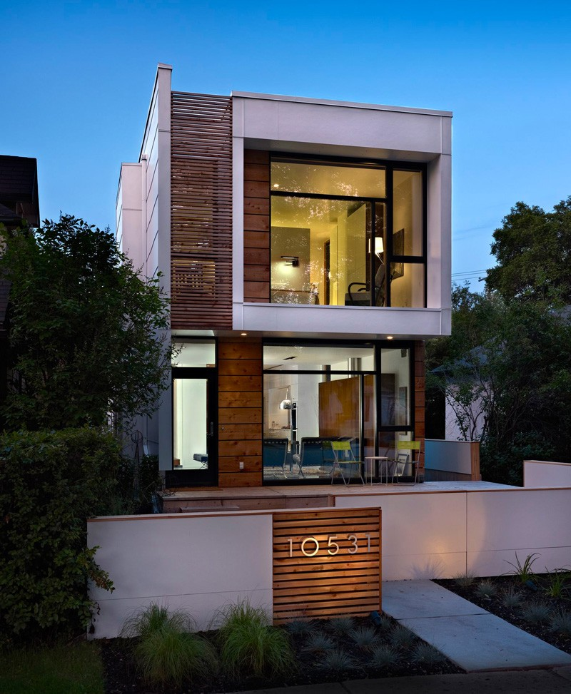 A narrow home that keeps its eyes on the street for Modern home plans for narrow lots